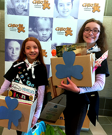 Clara and Fiona from the 1st Wakefield Guides with donations for CHEO